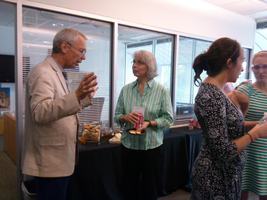 Ringling director Steven High talks with MEX doctoral student Susan Mann. Sarah Gladwin appears on the right.