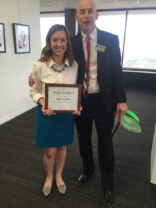 Marit Evans holding Arts Advocacy award with Associate Dean of the College of Fine Arts, Dr. Scott Shamp