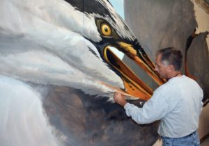 """Artist Michael Rosato painting a mural entitled """"Big Bird"""" in his studio in Cambridge, Maryland. Rosato is a 1983 graduate of Florida State University. (Photo: Special to the Democrat)"""
