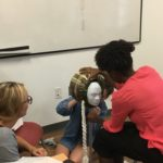 Students engage in a found object sculpture task during Therapeutic Use of Art Materials class