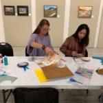 "Students help prepare activities for families_Hurricane Michael Survivors in Port St Joe at ""the Joe"" their community art center"
